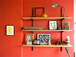 Red Wall Living Room Decorating Living Room Designs Simple Living Room Wall Shelves On The Red