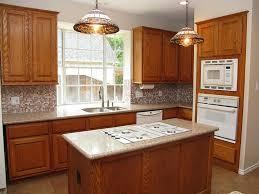 corner sinks design showcase: corner kitchen sink design with double stainless steel sink on granite countertop wooden cabinet ceramic floor pendant lamps