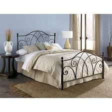 black polished wrought iron platform bed frame with curved headboard and footboard using light brown comforter black wrought iron furniture