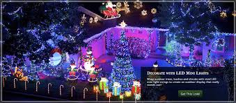 outdoor christmas lighting ideas. wrap trees bushes and shrubs with mini christmas lights outdoor lighting ideas b