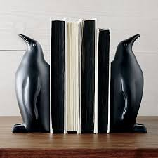 proud penguins team up in black powdercoated aluminum to prop up books and look great on aluminum crate barrel