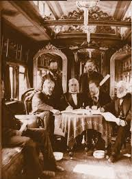 「he presidents of the Union Pacific and Central Pacific railroads meet in Promontory, Utah, and drive a ceremonial last spike into a rail line that connects their railroads.」の画像検索結果