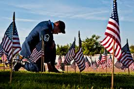 u s department of defense photo essay air force master sgt robert lilly pays his respects to a fallen veteran at the