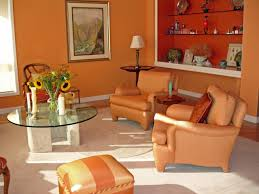 sitting nook with vibrant orange chair burnt orange living room furniture