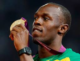 Jamaica's Usain Bolt displays his gold medal during the presentation ceremony for the men's 200m at the Olympic Stadium in London. - jamaica_s_usain_bolt_displays_his_gold_medal_durin_50245981e0