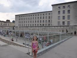 in der schule in berlin roaming jones vivian standing near an exposed area of the berlin wall across the street from the