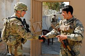 u s department of defense photo essay a u s ier left and afghan border policeman exchange greetings after learning they were