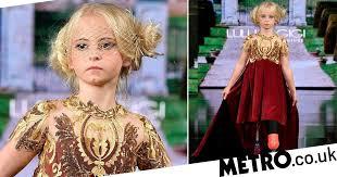 Nine-year-old <b>double</b> amputee walks the runway at New York ...