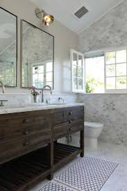washstand bathroom pine: the rustic wood vanity is a striking contrast to the extravagant carrara marble floor and wall