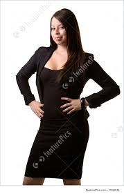 confident career w image confident brunette w in professional business suit standing hands on hips on white