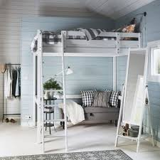 a white bedroom with a white stor loft bed emmie grey quilt cover and a bedroom furniture in ikea