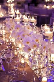 day orchid decor: orchids mirrors and candle lit christian oth studio bellethemagazinecom