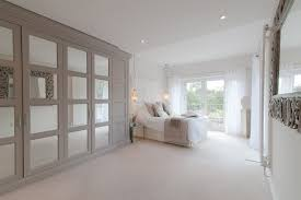 pilgrims way transitional bedroom photo in london with white walls and carpet architecture ideas mirrored closet doors