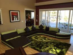 green black mesmerizing: source  u shaped black green leather extra large sectional sofas with backrest and square cushions added by black green fur rug on laminate flooring