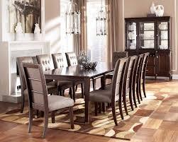 elegant square black mahogany dining table: parquet flooring design with elegant square kitchen table plus tufted back chairs and romantic pendant lighting