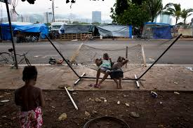 paradise lost as hawaii homelessness surges solutions remain two children play on a hammock at a homeless encampment in the kakaako district of honolulu