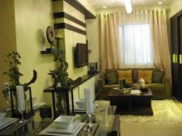 space living room olive:  fabric upholstery sofa facing cube wooden table over white hairy rug and cute accessories on