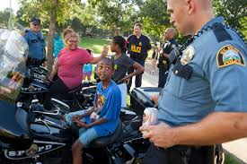if you don t understand black lives matter after terence an officer the st paul police department lets children sit on his motorcycle during an 2016 safe summer nights event designed to let police