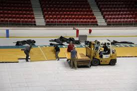 globetrotters return tonight news sports jobs adirondack state olympic regional development authority workers monday put together the basketball court flooring over the ice