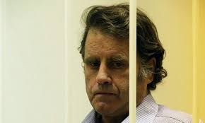 Captain of the Arctic Sunrise Peter Willcox behind bars at his court hearing in Saint Petersburg. Photograph: Anatoly Maltsev/EPA - Captain-of-the-Arctic-Sun-009