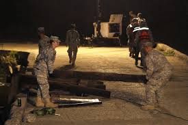 u s department of defense photo essay california army national guardsmen carry railroad track ties as they worked into the night to construct