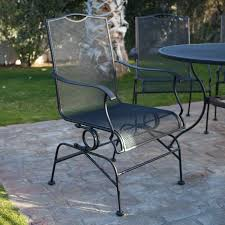 outdoor dining chairs in black made of iron and round dining table by woodard furniture for black outdoor balcony furniture