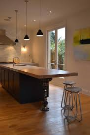 black kitchen island lighting above butcher block table adhered by stained formica countertop also wall mount black kitchen island lighting