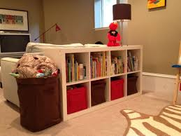 if we every want a tv in the basement againwe could turn the couches aroundget a sectional and add this i like the couchexpedit shelving dividing the basement office setup 3 primary