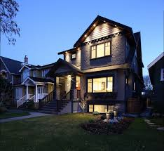 custom luxury home designs with pointed roof and large glass windows also white shade lighting