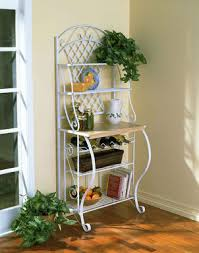 white kitchen rack holds cookbooks fruit and dishes best kitchen furniture