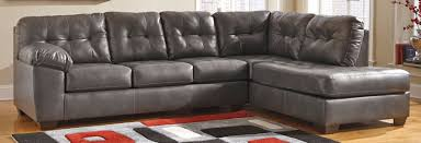 room ashley furniture sectional leather