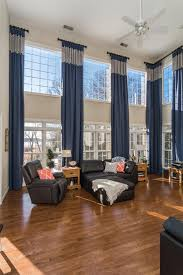 Window Dressing For Living Rooms Two Story Great Room Update Window Treatments Tall Window