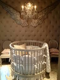 minimalist white wooden round baby crib with soft white bedding accessories decorating also awesome beige baby baby nursery furniture designer
