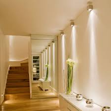 decoration charming narrow hallway lighting ideas with ceiling to floor mirror and laminated wooden flooring ceiling mounted spot lighting