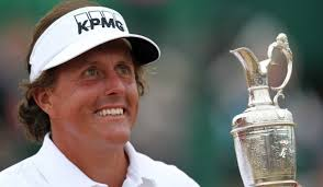 U.S. golfer Phil Mickelson poses for pictures with the Claret Jug after winning the 2013 British Open Golf Championship on July 21, 2013. (Getty Images)