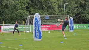 photo essay a look into leadership and team cohesion study ucd s goalkeeping coach gerrard barron having a one on one practice session