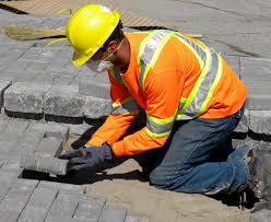 summer jobs grants  worker installing pavers