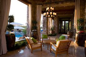 pillar candle chandelier patio mediterranean with accent pillows architectural elements beautiful living room pillar
