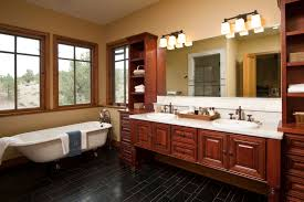 adorable master bathroom designs applying black flooring tile with white freestand bathtub furnished with dark brown bathroom track lighting master bathroom ideas