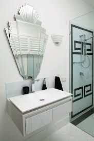 art deco example of a trendy bathroom design in melbourne with a vessel sink and white art deco mid century dining