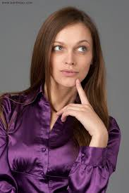 woman with long straight hair wearing a purple satin blouse A: It is possible that the frequent heat styling has caused the cuticle layer to open ... - satinblouse