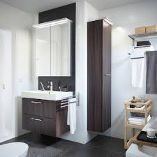 washstand bathroom pine: a white bathroom with godmorgon washstand in black brown and molger trolley in birch