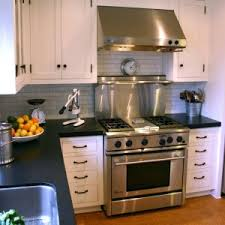 nice types of countertops with white kitchen cbainet and tile backsplash also kitchen hood nice types kitchen