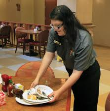 norman academy offers special needs students training photo fernanda garcia clears a restaurant table at an embassy suites in norman as part