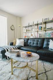 mix of old and new living room with black leather sofa black leather living room
