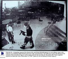 「On this day in 1999, two teenage gunmen kill 13 people in a shooting spree at Columbine High School in Littleton, Colorado, south of Denver.」の画像検索結果