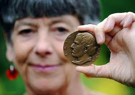 FASCINATION: Author Tessa West with a medal of prison reformer John Howard - 496567332