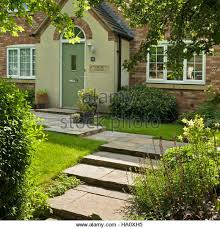 england style steps: attractive modern cottage style house with stone steps and path in front garden leicestershire