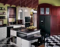 black appliance matte seamless kitchen: ge profile kitchen with black appliances green walls and white cabinets