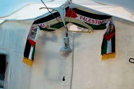 photo essay continually displaced palestinian refugees spend a small scarf adorns the plastic wall of one of the tents at baharka camp